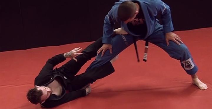 Photo of Brazilian Jiu-Jitsu world champion Kristian Woodmansee demonstrating Reverse De La Riva Guard position